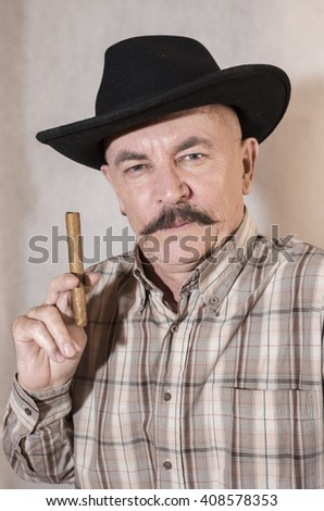 The cowboy with mustache, in a black hat smoking a cigar