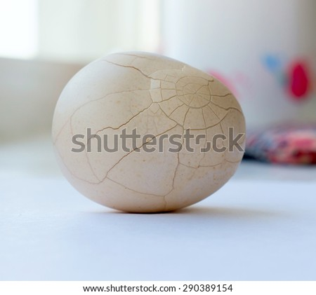 The crack white chicken egg. - stock photo