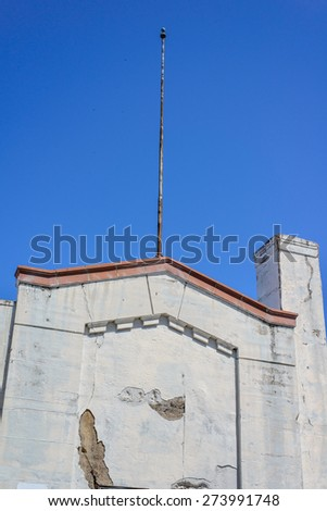 The cracked and fading facade or front tower of the old abandoned stadium dating back to the early 1900s  - stock photo