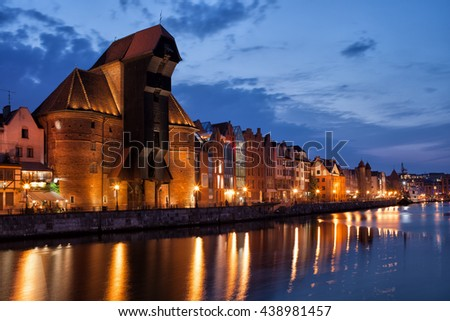 The Crane in city of Gdansk in Poland by night, Old Town skyline from Motlawa River