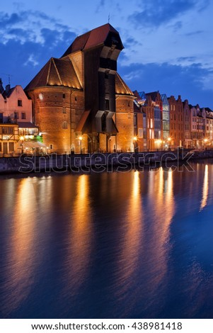 The Crane in Gdansk, Poland by night at Motlawa River, Old Town city symbol, 15th century landmark, historic monument - stock photo