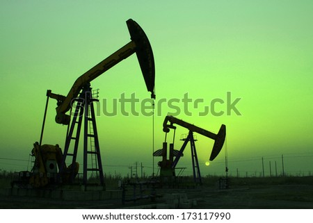 The crank balanced beam pumping unit under the curtain of night in the JiDong oilfield, on December 1, 2013, caofeidian, hebei province, China.   - stock photo