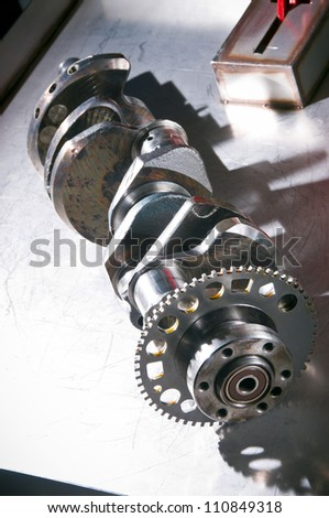 The crankshaft from a sports car engine - stock photo