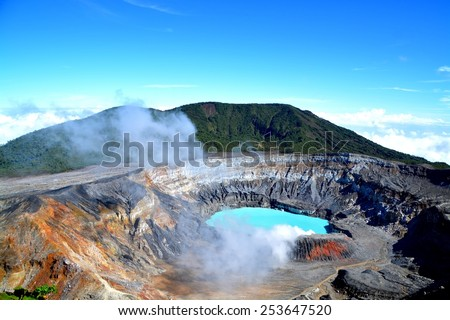 The crater and the lake of the Poas volcano in Costa Rica - stock photo