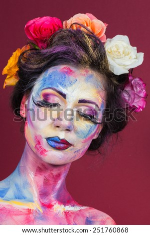 The creative, bright, color makeup. . Beautifully painted lips and eyes. Tone, powder, make-up. Multi-colored roses in her hair girl. - stock photo
