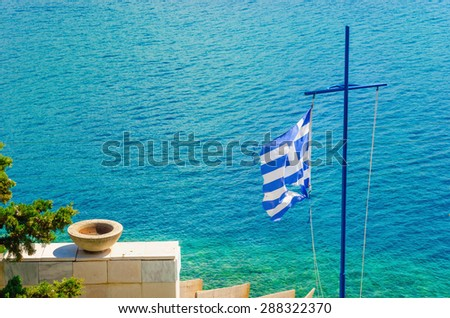 The Cross and the Greek flag on the background of the sea, Greek Islands, Aegean Sea - stock photo