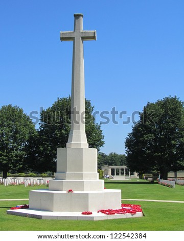 The Cross of Sacrifice memorial, Bayeux Military Cemetery, Normandy  It is the largest Second World War cemetery of Commonwealth soldiers in France. - stock photo