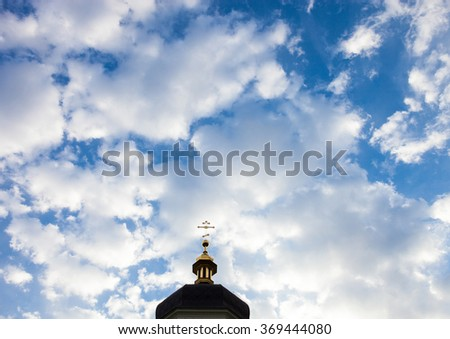 The cross of the orthodox Christian church against the cloudy sky background. - stock photo
