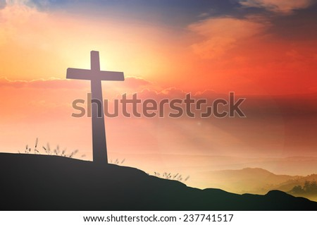 The cross on mountain sky sunset symbol for christian, easter and Jesus Christ.