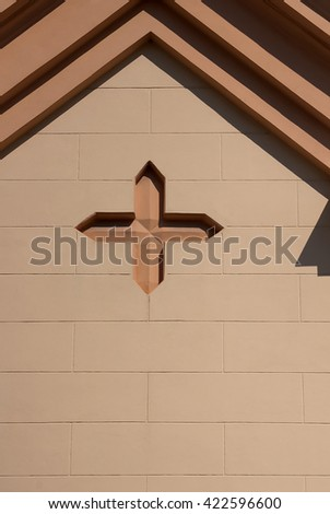 The cross on the facade of the church - stock photo