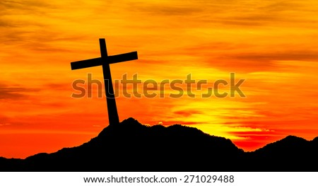 The cross on the hill - stock photo