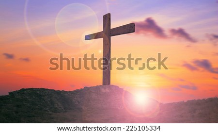 The cross on the mountain golgotha representing the day of christs crucifixion in a sunset. - stock photo