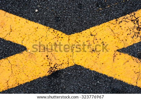 THe cross yellow line on asphalt
