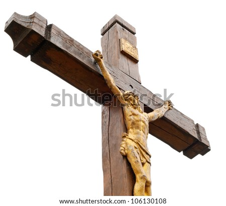 The crucifixion from a tree with Jesus's gilt figure. It is isolated on a white background. - stock photo
