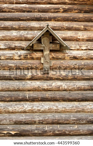 The Crucifixion of Jesus Christ on a wooden wall - stock photo