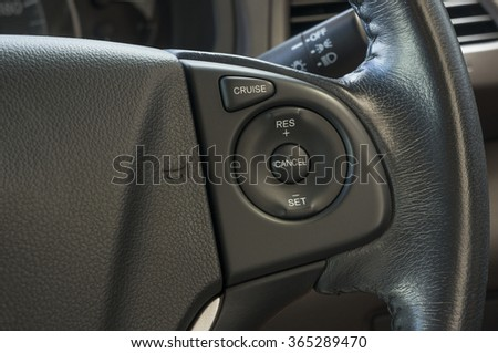 the cruise control button on a steering wheel - stock photo