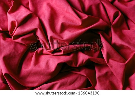 The crumpled red fabric - stock photo