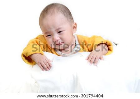 The crying boy, on white background - stock photo