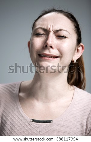 The crying woman with tears on face closeup - stock photo