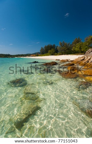 The crystal clear transparent water and rocks on perfect paradise island of Koh Lipe (aka Ko Lipeh), Thailand.  Vertical - stock photo