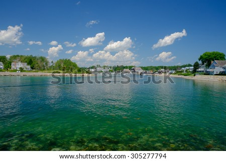 The crystal clear waters of Maine and the entrance to the harbor at the Kennebunkport Inlet - stock photo
