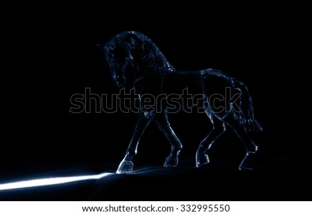 The crystal horse in the moonlight on black background