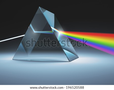 The crystal prism disperses white light into many colors. - stock photo