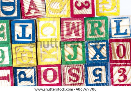 The cubical wooden with letter arranged disorderly suitable for background.