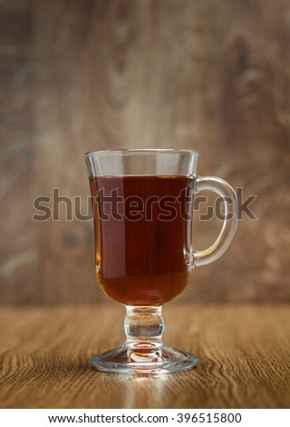 the cup of tea on a wooden background - stock photo