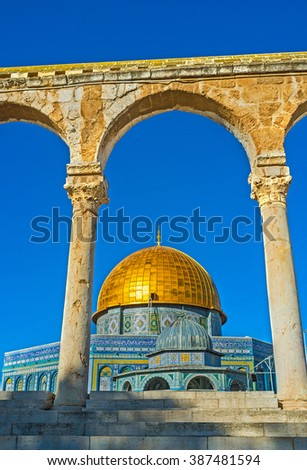 The cupola of the Dome of the Rock and the smaller one - of the Dome of the Chain, seen through the Scales of Souls colonnade, Jerusalem, Israel.