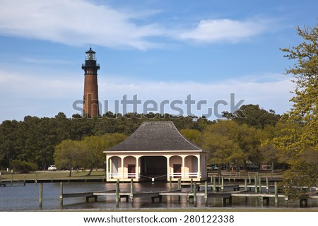 The Currituck Beach Lighthouse is in Corolla on the Outer Banks and is a popular attraction in the area. - stock photo
