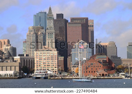 The Customs House Clock Tower, the American Flag Flying, and Boston Skyline, Massachusetts, New England. - stock photo