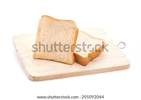 The cut loaf of  white bread on Chopping Block. isolated on white background