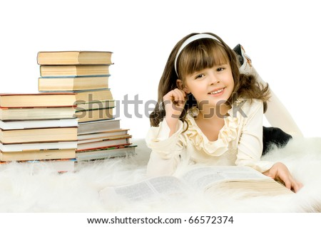 the cute little girl lie with textbook and happy smile, on white background, isilated