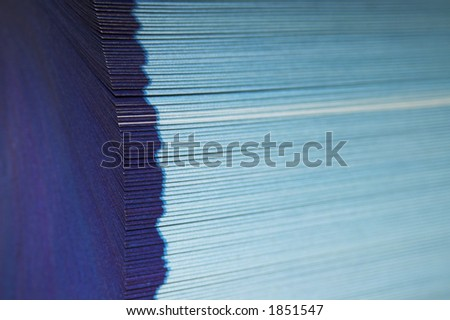 The cutting face of a phone directory with fanned pages. - stock photo
