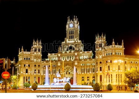 The Cybele Palace (Palacio de Cibeles) or the Palace of Communication and the fountain on the Cybeles Square (Plaza de Cibeles) in Madrid at evening. Madrid is a popular tourist destination of Europe. - stock photo