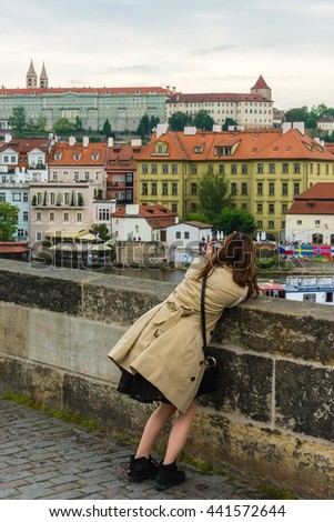 THE CZECH REPUBLIC, PRAGUE - MAY 19: Woman is taking pictures on the Charles bridge in Prague, Czech on May 19, 2015
