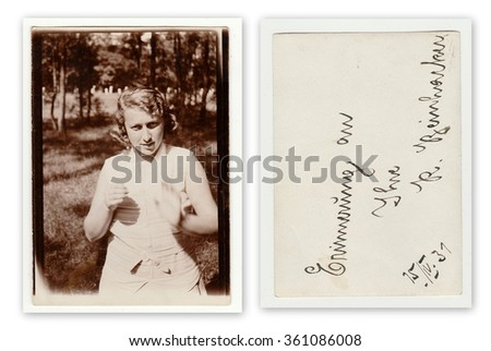 THE CZECHOSLOVAK REPUBLIC, APRIL 15: Front and back of vintage photo of a young girl in nature, April 15, 1931. - stock photo