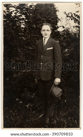 THE CZECHOSLOVAK REPUBLIC - CIRCA 1940s: Vintage photo shows man wears suit with an elegant hat poses outdoors. Black & white antique photo.
