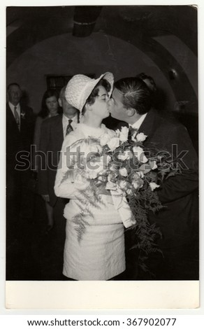THE CZECHOSLOVAK  SOCIALIST REPUBLIC, CIRCA 1970: A vintage photo shows wedding photo  - bridal kiss, circa 1970.