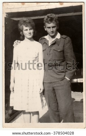 THE CZECHOSLOVAK SOCIALIST REPUBLIC - CIRCA 1950s:  An antique Black & White photo shows soldier and his girlfriend.