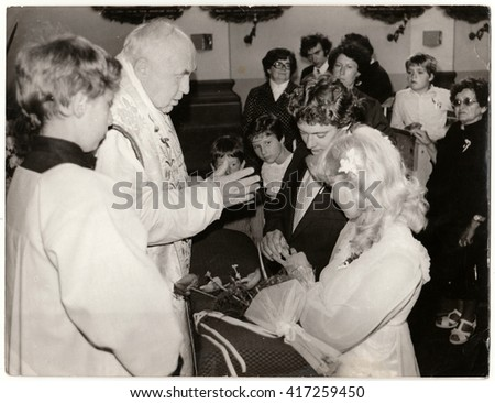 THE CZECHOSLOVAK SOCIALIST REPUBLIC - CIRCA 1970s: Retro photo shows a rural wedding ceremony in a church. Black & white vintage photography.