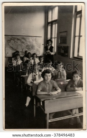 THE CZECHOSLOVAK SOCIALIST REPUBLIC - CIRCA 1960s:  Vintage photo shows pupils sit at the school wooden desk in classroom.
