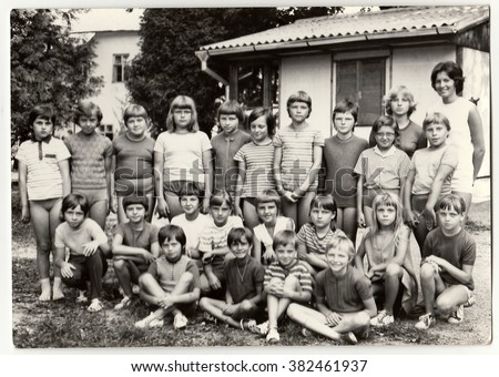 THE CZECHOSLOVAK SOCIALIST REPUBLIC - CIRCA 1980s: Vintage photo shows teenagers and female chiefs at summer camp.