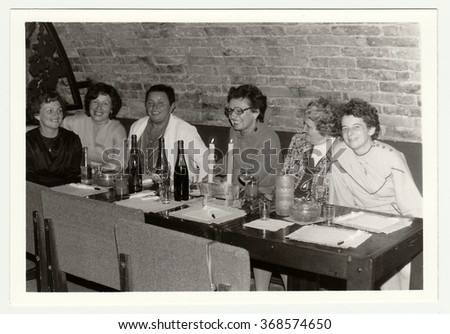 THE CZECHOSLOVAK SOCIALIST REPUBLIC, 1985: Vintage photo shows a group of people in a wine bar.