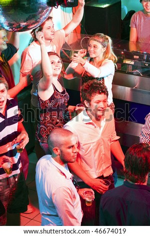 The dance floor of a crowded club with lots of people dancing - stock photo