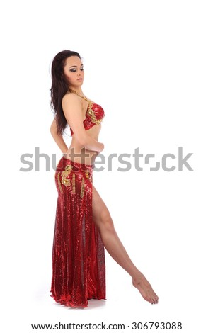The dancer of belly dance in east costume in studio