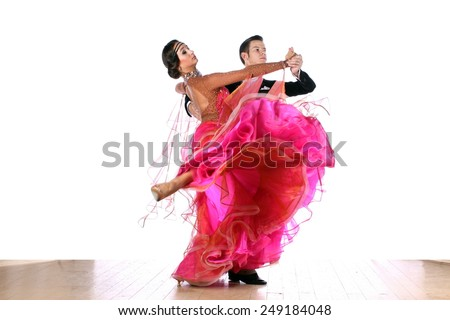 The dancers in ballroom against white background - stock photo