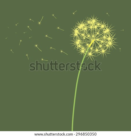 The dandelion which is blown a wind on a light green background.