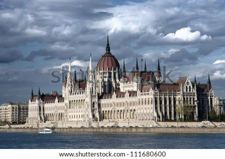 the Danube River and the Hungarian Parliament against a dramatic sky - stock photo